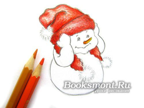 Желтым карандашом раскрашиваем нос снеговика, который в виде морковки